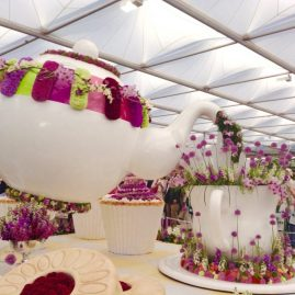 Amazing flower display with teacups and saucers.
